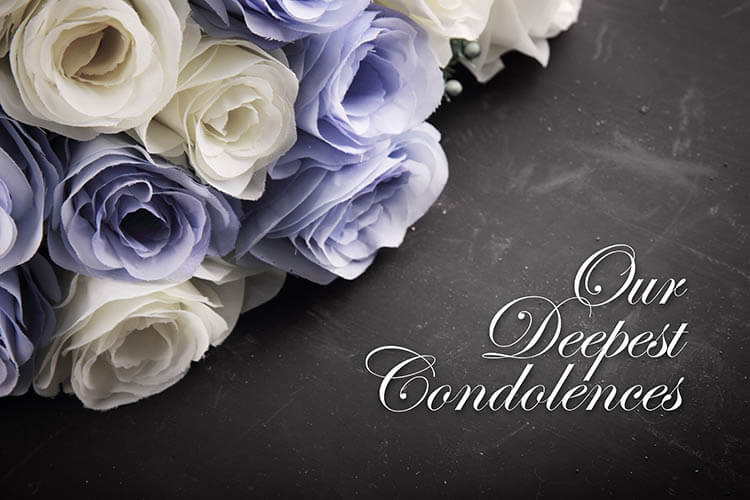 """White and purple roses and the words """"our deepest condolences"""""""